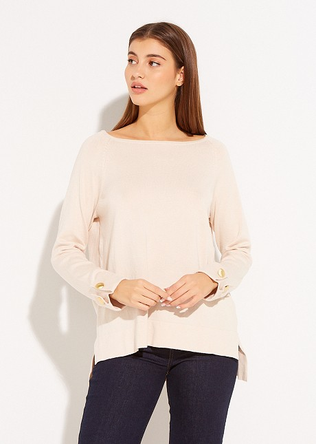 Sweater with decorative button