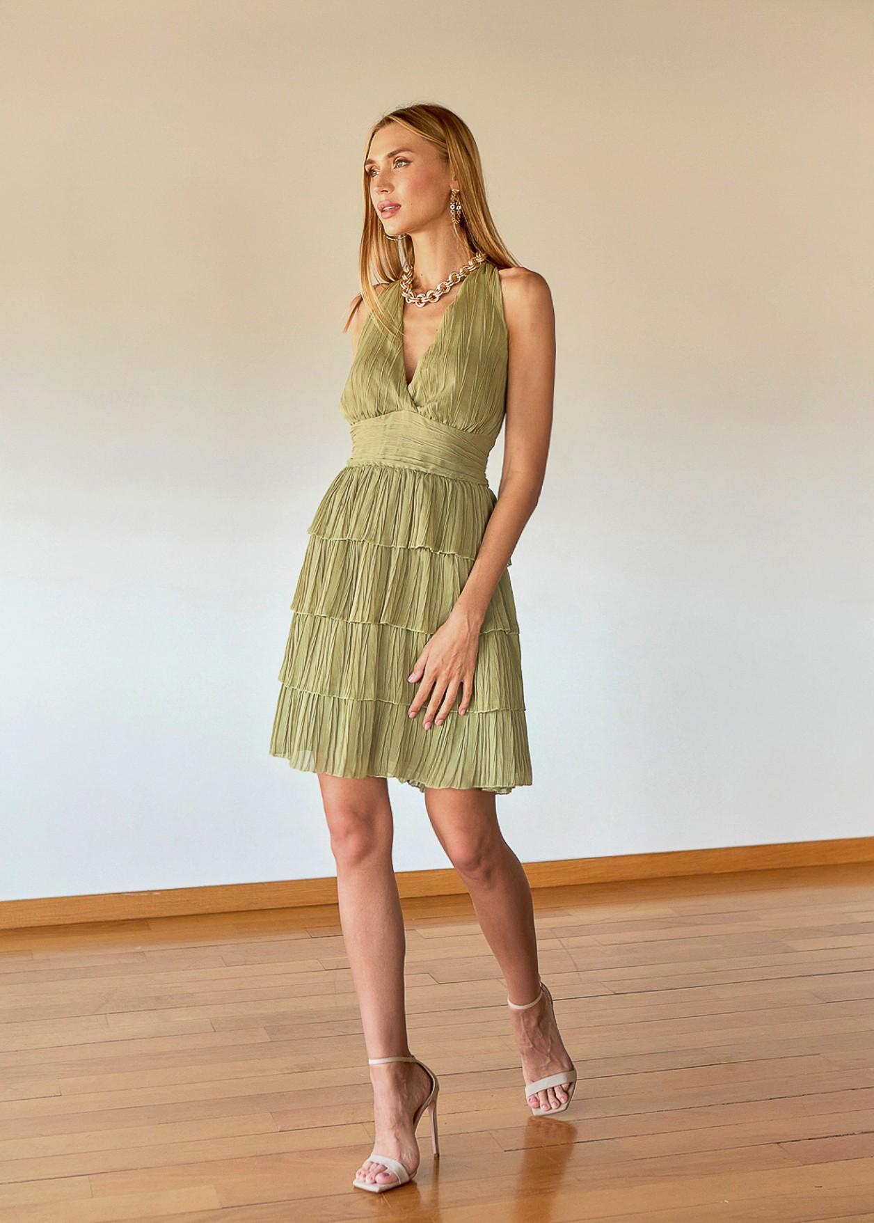 Pleated dress with ruffles