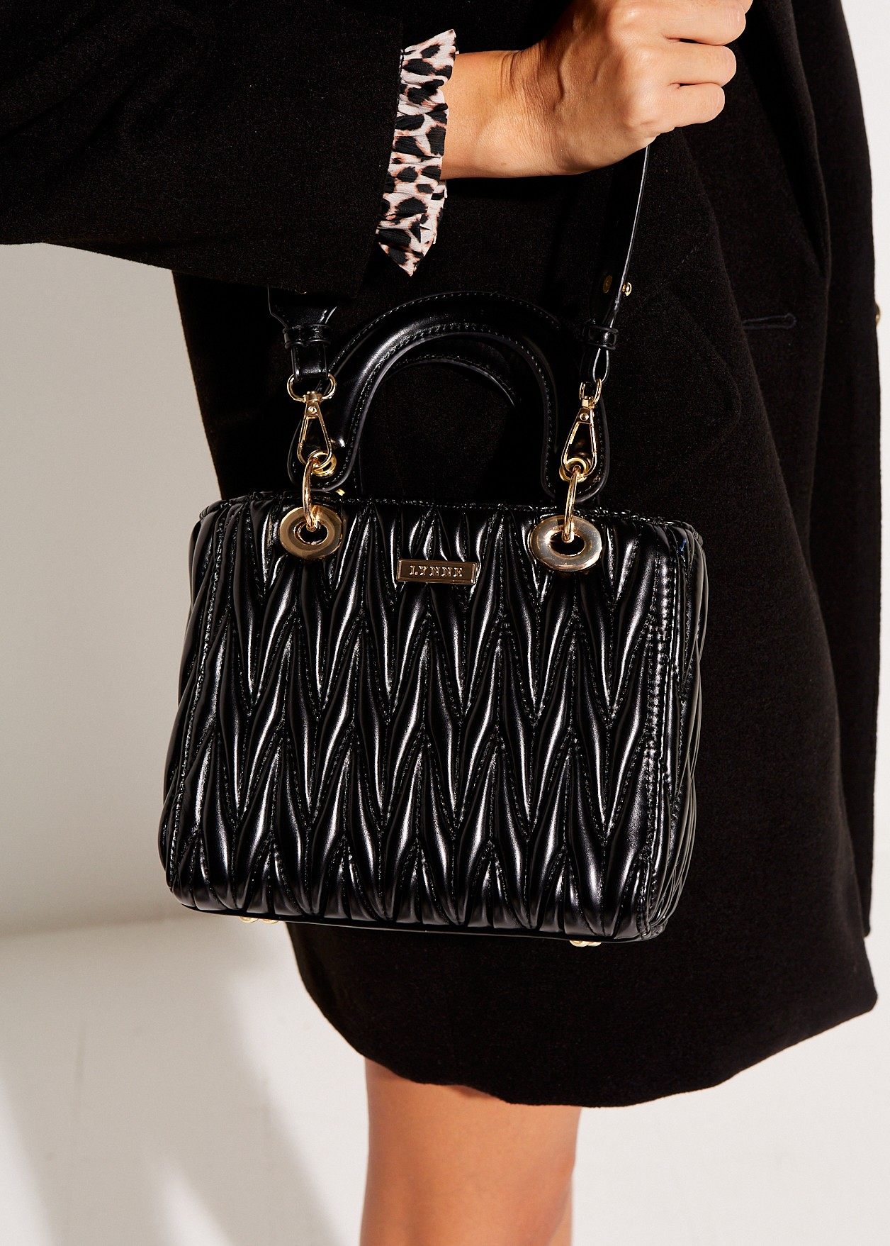 Textured bag with handgrips