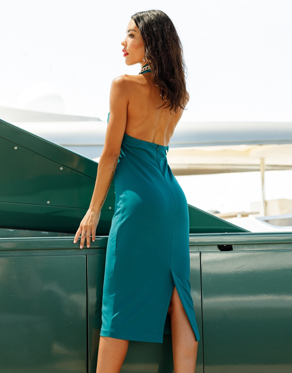 Open back dress with necklace