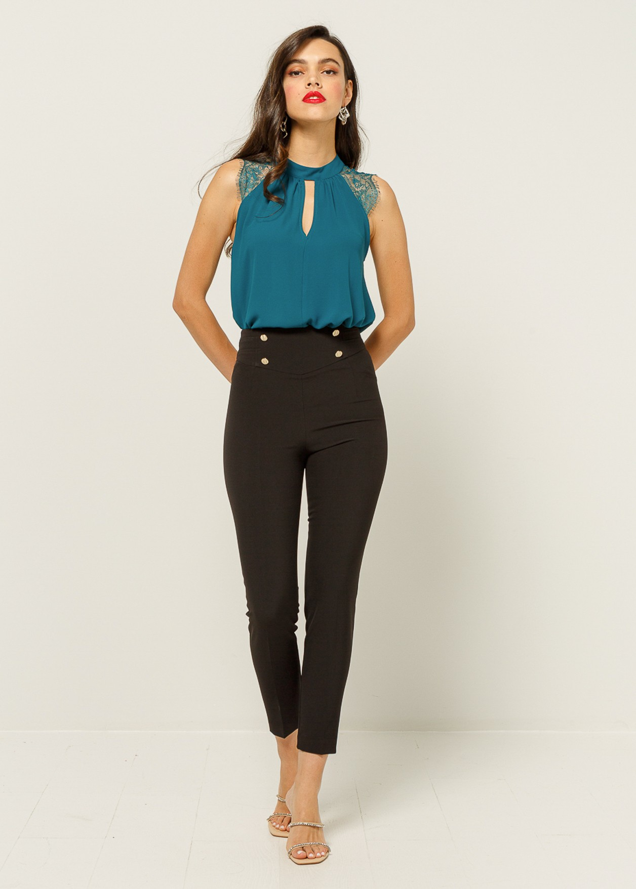 Trouser with decorative buttons